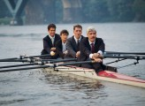 Businesspeople rowing scull